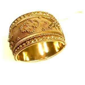 Gold colored metal bangle